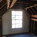 The original loft exposed and ready for alterations.