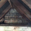 Central chimney supporting the ridge beam.