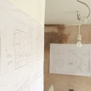 The drawings prepared by the client hung and waiting for action by the builder.